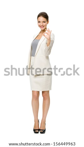 Full-length portrait of businesswoman ok gesturing, isolated on white. Concept of leadership and success - stock photo