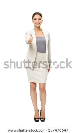 Full-length portrait of businesswoman who thumbs up, isolated on white. Concept of leadership and success - stock photo