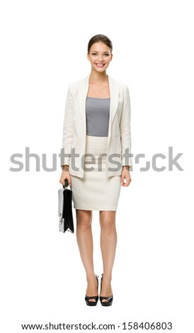Full-length portrait of businesswoman with case, isolated on white. Concept of leadership and success - stock photo