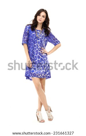full-length portrait of casual fashion woman standing in studio  - stock photo
