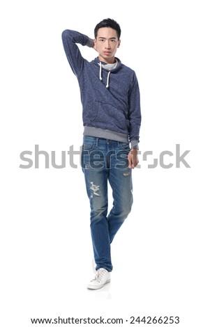Full length Portrait of casual man walking in studio - stock photo