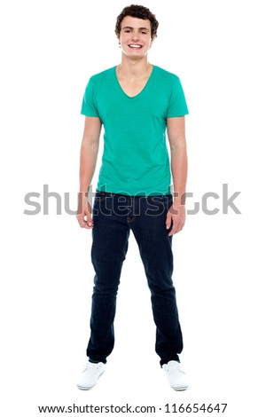Full length portrait of casual teenager looking at camera and smiling - stock photo