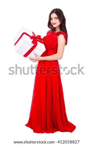 full length portrait of cheerful woman in red dress with big gift box isolated on white background - stock photo