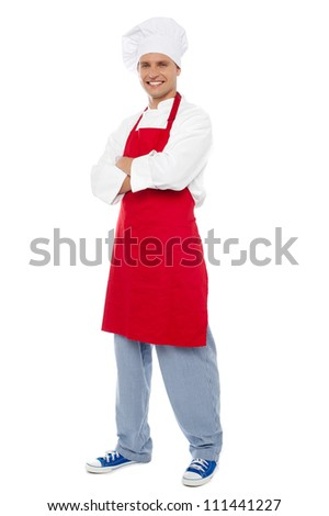 Full length portrait of chef posing in style isolated over white background - stock photo