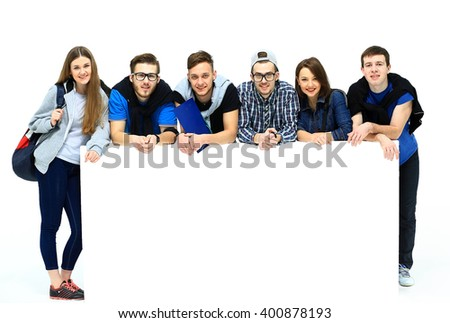 Full length portrait of confident college students displaying blank billboard against white background - stock photo