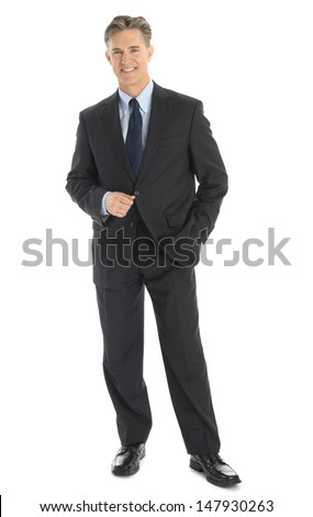 Full length portrait of confident mature businessman in formals standing isolated over white background - stock photo