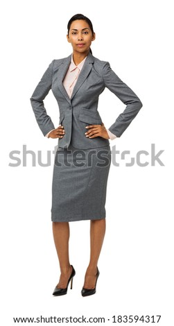 Full length portrait of confident well-dressed businesswoman with hands on hips isolated over white background. Vertical shot. - stock photo