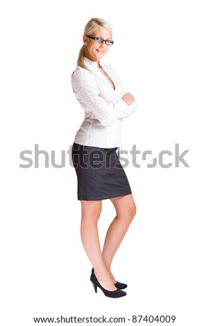 Full length portrait of confident young business woman isolated on white background. - stock photo