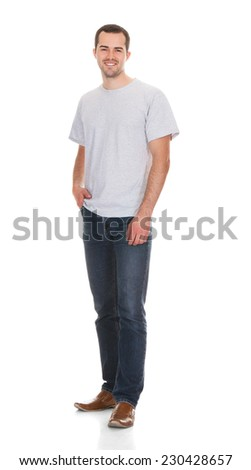 Full length portrait of confident young man in casuals standing against white background - stock photo