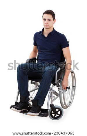 Full length portrait of confident young man sitting in wheelchair isolated over white background - stock photo