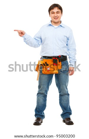 Full length portrait of construction worker pointing on side - stock photo