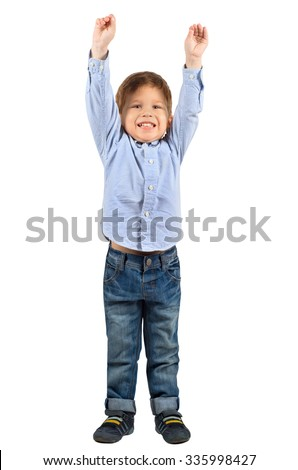 Full length portrait of cute little boy with hands up isolated on white background - stock photo