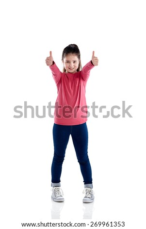 Full length portrait of cute little girl showing thumbs up with both hands on white background - stock photo