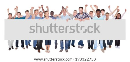Full length portrait of diverse people in casuals holding blank placard over white background - stock photo