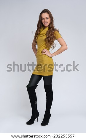 full length portrait of fashionable woman. Studio shot - stock photo