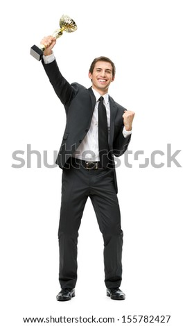 Full-length portrait of gesturing fists up businessman with gold cup, isolated on white. Concept of win and success - stock photo