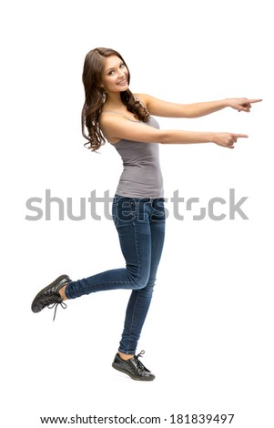 Full-length portrait of girl pointing hand gesturing, isolated on white - stock photo