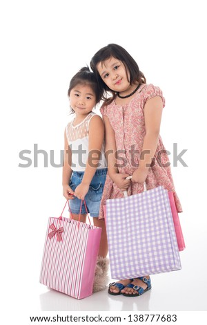 Full-length portrait of girlfriends tired from shopping on white - stock photo