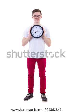 full length portrait of handsome teenage boy holding office clock isolated on white background - stock photo