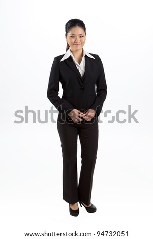 Full length portrait of happy Asian business woman - stock photo