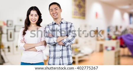 Full length portrait of happy couple against furniture and design store - stock photo