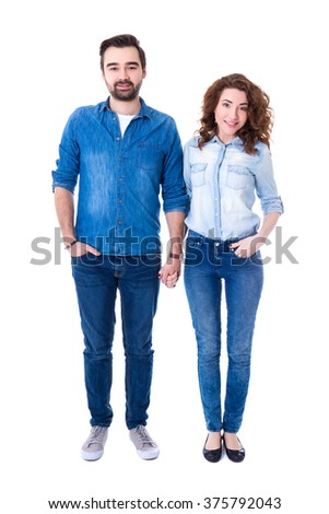 full length portrait of happy couple standing isolated on white background - stock photo
