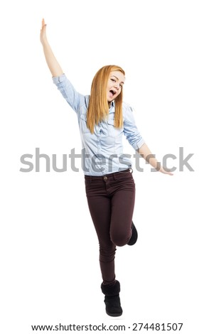 Full length portrait of happy excited girl jumping with arms extended  over white background - stock photo