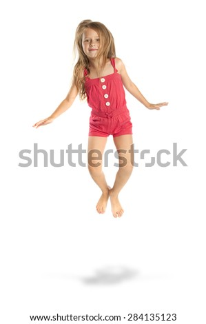 Full length portrait of happy little girl jumping, isolated on white background - stock photo