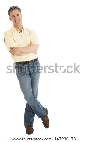Full length portrait of happy mature man in casuals standing arms crossed over white background - stock photo