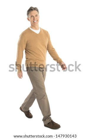 Full length portrait of happy mature man walking isolated over white background - stock photo