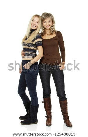 Full length portrait of happy mother and teen daughter, over white - stock photo