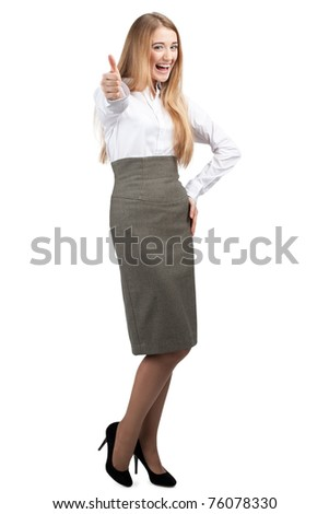 Full length portrait of happy young businesswoman showing thumbs up, isolated on white background - stock photo