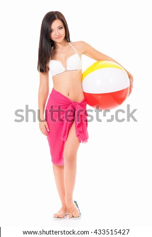 Full length portrait of happy young woman in swimsuit with beach ball, isolated on white background - stock photo