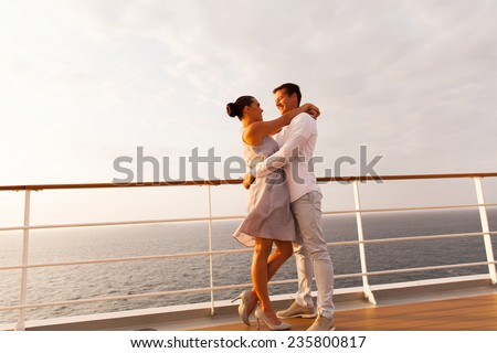 full length portrait of lovely couple hugging on cruise - stock photo