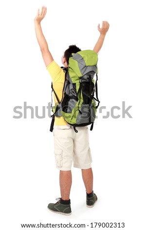 Full length portrait of male hiker with backpack raised his arm. shoot from behind isolated on white background - stock photo