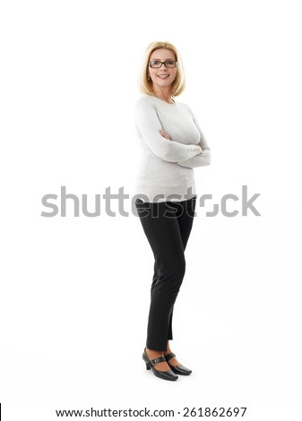 Full length portrait of mature business woman standing against white background.  - stock photo