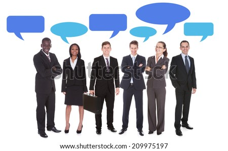 Full length portrait of multiethnic business people with speech bubbles over white background - stock photo