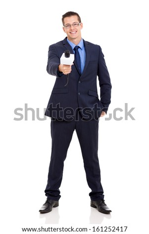 full length portrait of news reporter interviewing with microphone - stock photo