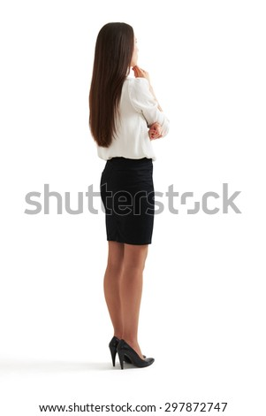 full-length portrait of pensive woman in formal wear. isolated on white background - stock photo
