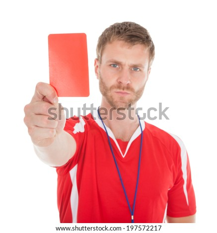 Full length portrait of referee showing red card over white background - stock photo