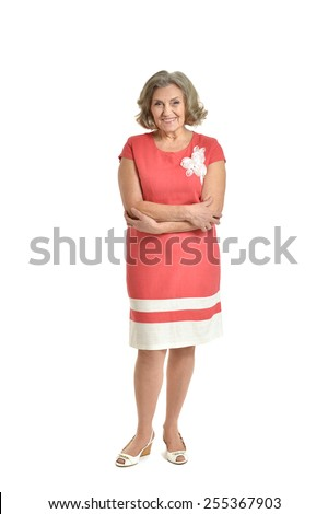 Full length portrait of senior woman in red dress on white background - stock photo