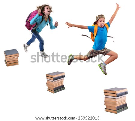 full length portrait of shouting jumping boy and girl over piles of books isolated over white - stock photo