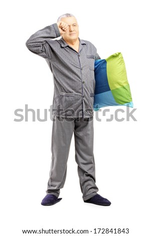 Full length portrait of sleepy middle aged man in pajamas holding a pillow isolated on white background - stock photo