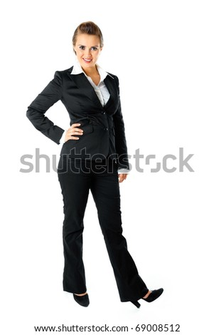 Full length portrait of smiling modern business woman isolated on white - stock photo