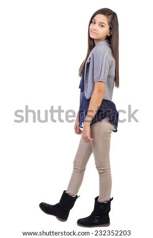 Full length portrait of  smiling teenage girl isolated on white background - stock photo
