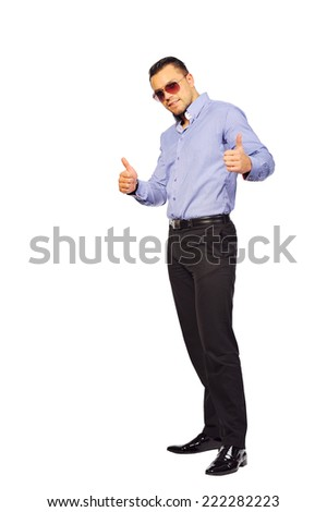 Full length portrait of stylish young man thumbs up white background - stock photo