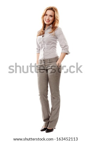 Full length portrait of successful businesswoman with hand on hip smiling, isolated on white background - stock photo