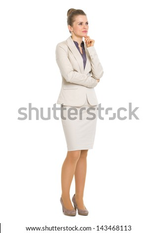 Full length portrait of thoughtful business woman looking on copy space - stock photo