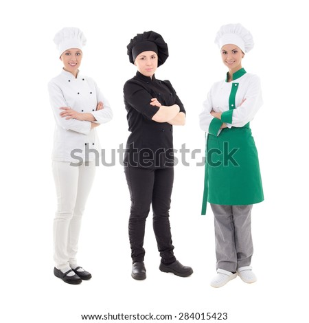 full length portrait of three young women chefs isolated on white background - stock photo