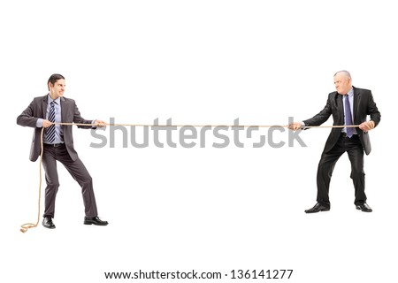 Full length portrait of two businessmen pulling a rope isolated on white background - stock photo